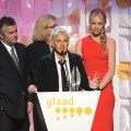 Ellen DeGeneres, with wife Portia de Rossi, accepts the award for Outstanding Talk Show Episode at the 20th Annual GLAAD Media Awards in LA