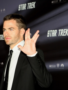 Chris Pine gives a Vulcan sign on the red carpet at the 'Star Trek' world premiere in Sydney