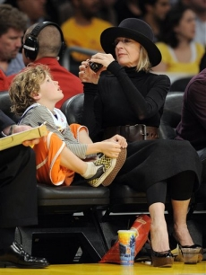 Diane Keaton takes a picture of her son Duke at the Lakers vs. Nuggets game on Thursday, April 9, 2009