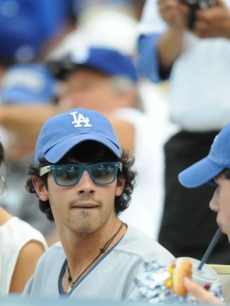 Camilla Belle, Joe Jonas and Nick Jonas at Dodger Stadium for opening day, April 13, 2009