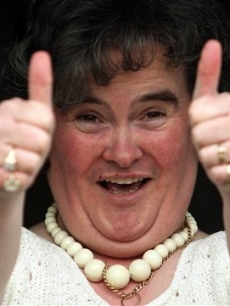 "Susan Boyle, who's performance on the television show ""Britain's Got Talent"" wowed the judges, gives the thumbs up at her home in Blackburn, Scotland, Thursday April 16, 2009"
