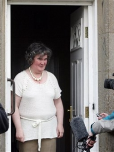 Susan Boyle, who&#8217;s performance on the television show &#8220;Britain&#8217;s Got Talent&#8221; wowed the judges, gives the thumbs up at her home in Blackburn, Scotland, Thursday April 16, 2009