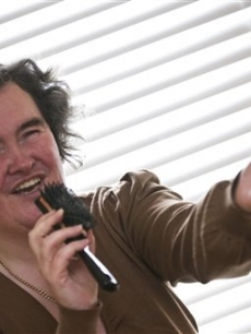 Susan Boyle, who&#8217;s performance on the television show &#8220;Britain&#8217;s Got Talent&#8221; wowed the judges, poses singing with a hairbrush at her home in Blackburn, Scotland, Thursday April 16, 2009