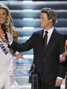 Miss California, Carrie Prejean, fields a question about gay marriage alongside hosts Billy Bush and Nadine Velazquez at the Miss USA pageant