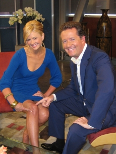 Nancy O'Dell and 'Britain's Got Talent' judge Piers Morgan pose on the Access stage