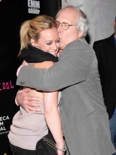 Chevy Chase gives 'Stay Cool' co-star Hilary Duff at hug on the red carpet