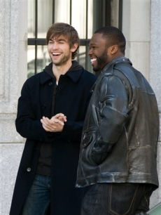 "Chace Crawford and Curtis ""50 Cent"" Jackson laugh between takes on the set of ""Twelve"" on April 27, 2009 in New York"