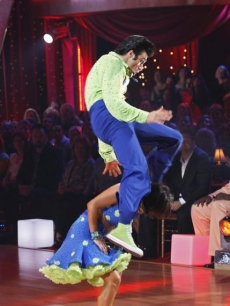 Gilles Marini and Cheryl Burke take flight while doing the lindy hop