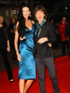 Mick Jagger and L'Wren Scott attend the premiere of 'Shine A Light' at the Odeon Leicester Square on April 2, 2008 in London, England