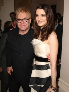 Sir Elton John and Rachel Weisz pose for a photo inside the Cartier celebration in NYC, April 30, 2009