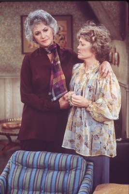Beatrice Arthur (as Maude Findlay) (left) comforts a distraught Rue McClanahan (as Vivian Cavender Harmon) in a scene from the television show 'Maude,' Los Angeles, California, mid 1970s