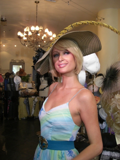 Paris Hilton tries on the perfect Kentucky Derby hat