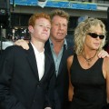 Ryan O'Neal and Farrah Fawcett arrive with their son Redmond at the premiere of 'Malibu's Most Wanted' at the Chinese Theater on April 10, 2003 in Los Angeles, California