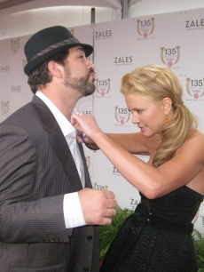 Nancy O'Dell gives Joey Fatone a hand at the Kentucky Derby