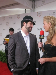 Nancy O'Dell interviews Joey Fatone at the Kentucky Derby