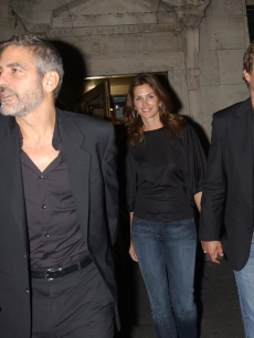 George Clooney, Cindy Crawford and Rande Gerber stand on a sidewalk in the early morning October 9, 2007 in New York City