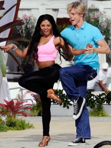 Lil Kim and Derek Hough show off their 'Dancing' moves for Regis and Kelly on their Miami Beach set
