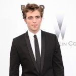 &#8216;Twilight&#8217; vampire Robert Pattinson sticks out his tongue at the amfAR Cinema Against AIDS 2009 benefit at the Hotel du Cap during the 62nd Annual Cannes Film Festival on May 21, 2009 