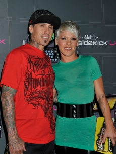 Carey Hart and Pink arrive at the T-Mobile Sidekick LX launch event at Paramount Studios on May 14, 2009 in Hollywood