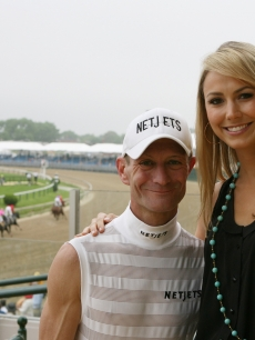 Stacy Keibler smiles with Kentucky Derby-winning jockey Calvin Borel just before his win at the Preakness Stakes