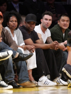 Denzel Washington sits next to his wife Pauletta (left) and Maroon 5 singer Adam Levine at the Lakers/Rockets game on May 17, 2009