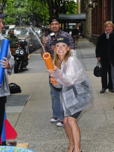 Kelly Ripa shoots water squirt gun on the &#8216;Live With Regis And Kelly&#8217; taping at ABC Lincoln Square Studio on May 18, 2009 in New York City