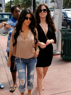 Kourtney Kardashian and Khloe Kardashian arrive at their new clothing store Dash on May 19, 2009 in Miami Beach, Florida