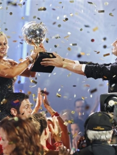 Shawn Johnson and Mark Ballas hold the trophy during 'Dancing with the Stars' finale show
