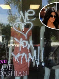 Kourtney and Khloe Kardashian pictured with the vandalism of the sisters' LA Dash boutique