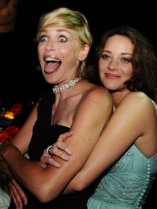 Sharon Stone and Marion Cotillard attend the amfAR Cinema Against AIDS 2009 dinner at the Hotel du Cap during the 62nd Annual Cannes Film Festival on May 21, 2009