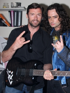 Hugh Jackman and Constantine Maroulis pose backstage at the hit musical 'Rock of Ages' on Broadway at The Brooks Atkinson Theater on May 21, 2009 in New York City