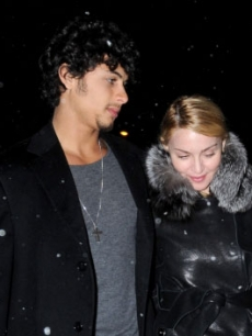 Madonna and model Jesus Luz are seen on the streets of Manhattan on March 1, 2009 in New York City