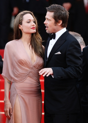 Angelina Jolie looks at her partner Brad Pitt as the couple head into his Cannes premiere for 'Inglourious Basterds'