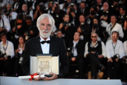 Austrian director Michael Haneke poses after being awarded with the Palme d'Or for his movie 'Das Weisse Band' (The White Ribbon), after the Closing Ceremony of the 62nd Cannes Film Festival on May 24, 2009