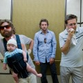 Zach Galifianakis, Bradley Cooper and Ed Helms sober up the hard way in 'The Hangover'