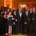 Elton John and the cast of 'Billy Elliot, The Musical' accept the award for best musical onstage during the 63rd Annual Tony Awards at Radio City Music Hall