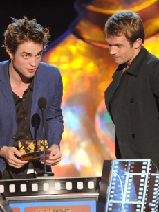 Robert Pattinson and Cam Gigandet on stage at the 2009 MTV Movie Awards