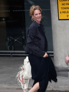 Uma Thurman is all smiles before the ARK Gala Dinner on June 4, 2009 in London
