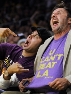 David Arquette and a pal joke around during the second half action at game one of the NBA basketball finals on June 4, 2009, in LA