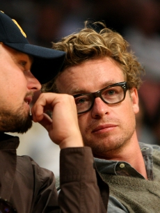 Leonardo DiCaprio and Simon Baker chat courtside during game two of the 2009 NBA Finals on June 7, 2009 in LA