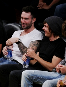 Adam Levine and Zac Efron share a laugh at game two of the NBA Finals on June 7, 2009 in LA