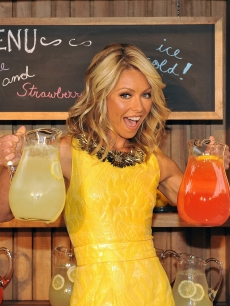 Kelly Ripa is all smiles in yellow during the Kelly Ripa and Electrolux Virtual Lemonade Stand Campaign announcement on June 8, 2009 in New York City