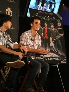 Kevin Jonas talks with the press during a press conference to promote the Jonas Brothers tour in Arlington, Texas on June 8, 2009