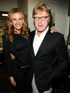 Julia Roberts and Robert Redford are all smiles at the celebration of Paul Newman's Hole in the Wall camps on June 8, 2009 in New York City