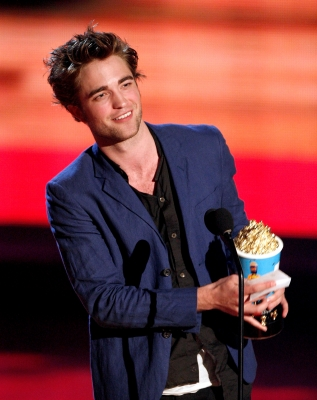 Robert Pattinson accepts the Breakthrough Male Performance awards onstage during the 18th Annual MTV Movie Awards
