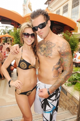 Audrina Patridge shows off her bikini bod with her brother, Mark Patridge Jr. at the TAO Beach on June 6, 2009 in Las Vegas