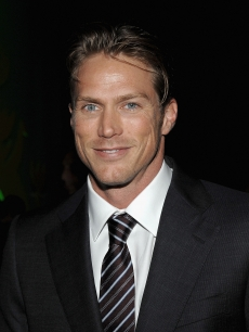 Jason Lewis flashes a grin at the the after party celebrating Paul Newman's Hole in the Wall Camps on June 8, 2009 in New York City