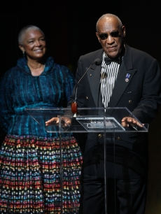 Bill Cosby and his wife Camille Cosby take the stage at the Apollo Theater 75th Anniversary Gala on June 8, 2009 in New York City