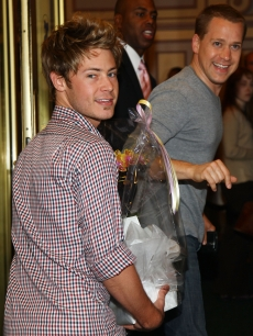 T.R. Knight and boyfriend Mark Cornelsen come bearing gifts at Chandra Wilson's debut in 'Chicago' on Broadway on June 8, 2009 in New York City.