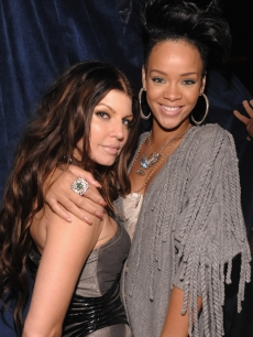 Fergie and Rihanna strike a pose at the official Black Eyed Peas album release party hosted by Target on June 10, 2009 in New York City